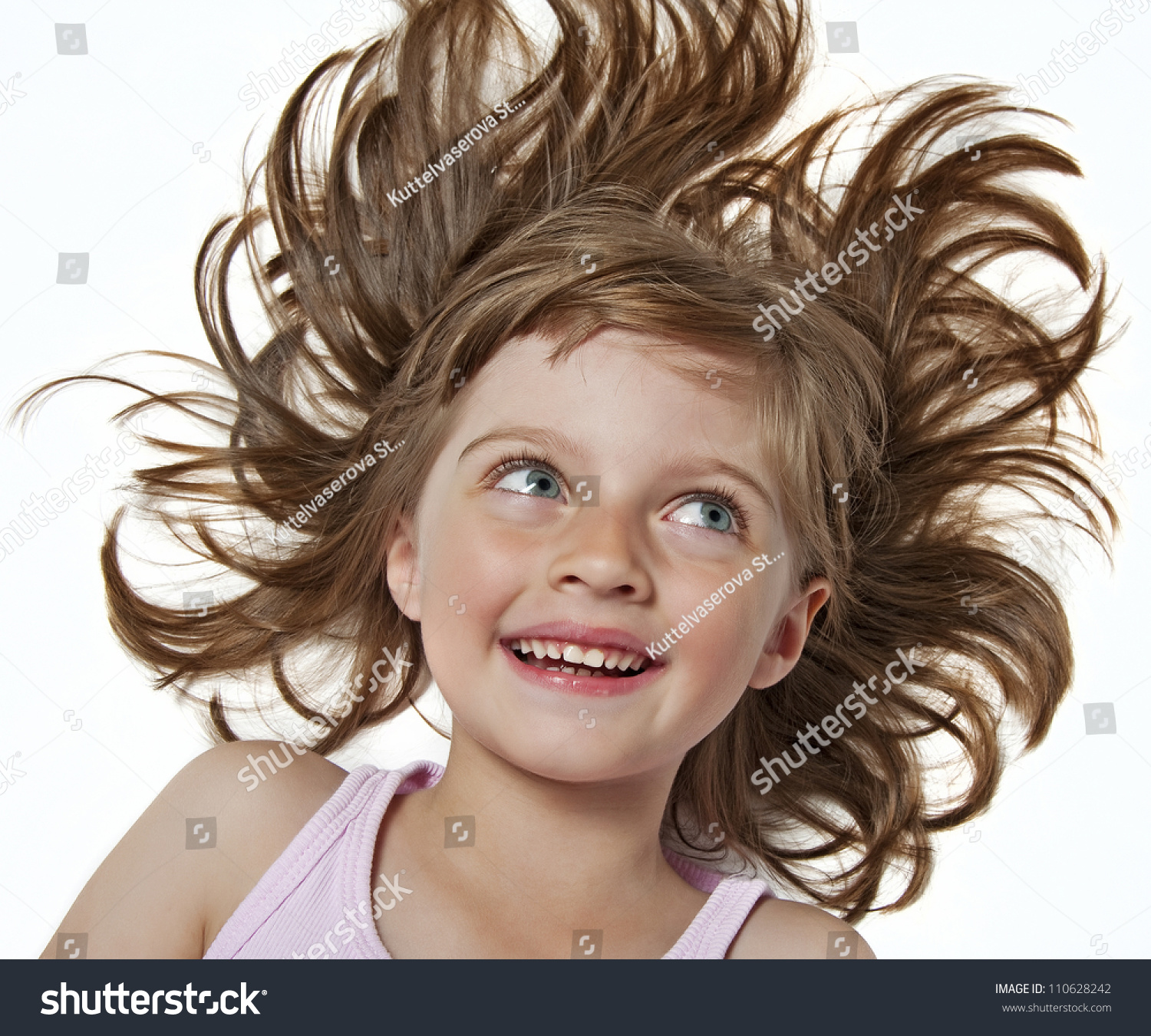 happy little girl with long nice wavy brown hair stock