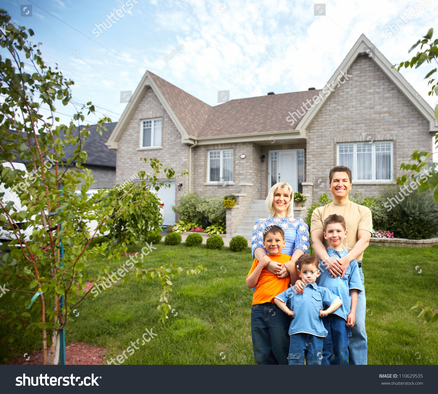 Happy family near new house real stock photo 110629535 for Modern realtors real estate
