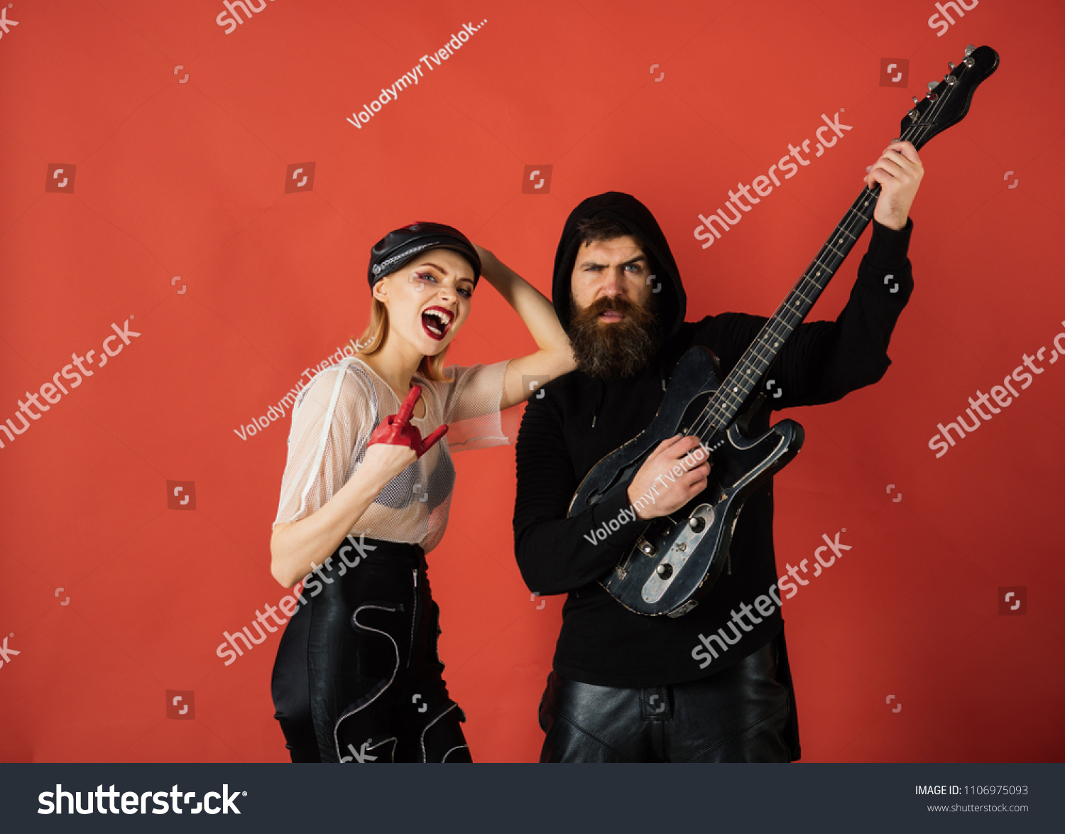 Rock couple of sexy girl and bearded man with guitar. cool rock and roll  couple