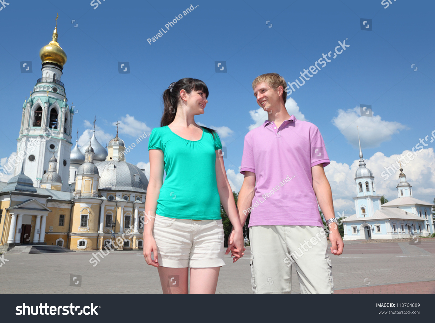young couple near holy resurrection cathedral stock photo