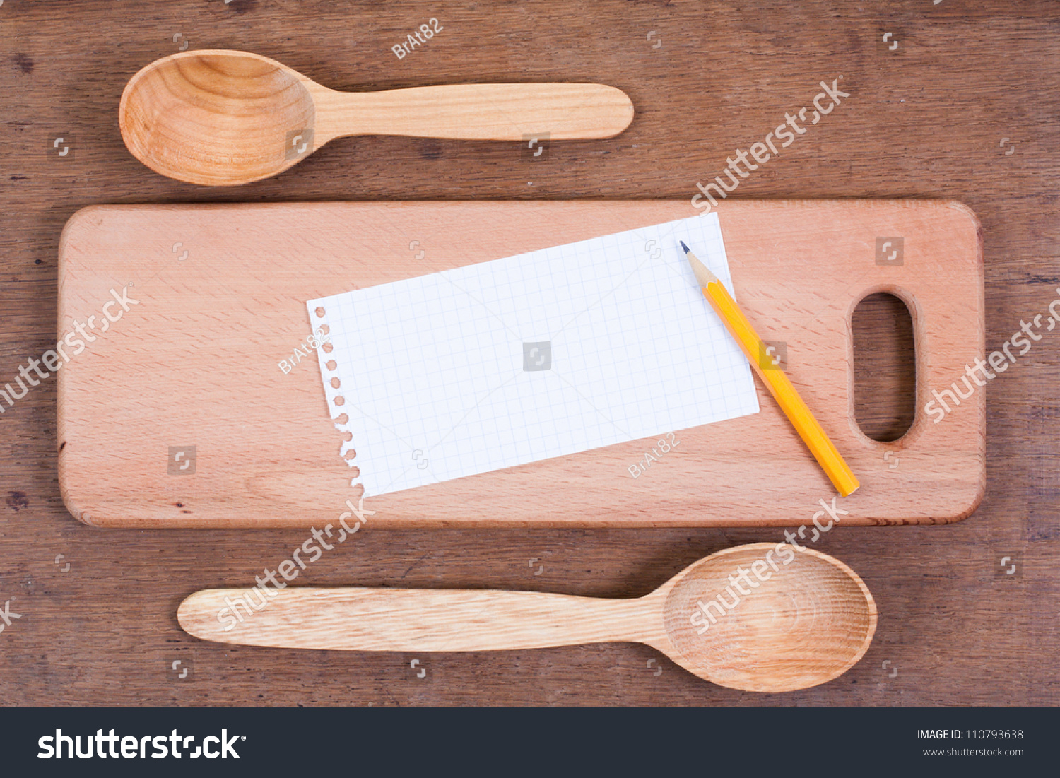 Wooden Spoons On Oak Wood Table Stock Photo (Edit Now