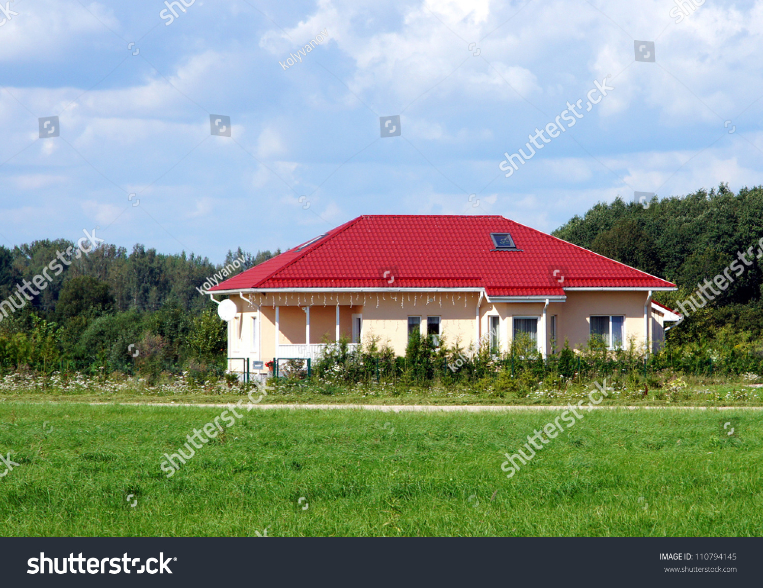 Modern Apartment House With A Red Roof Stock Photo