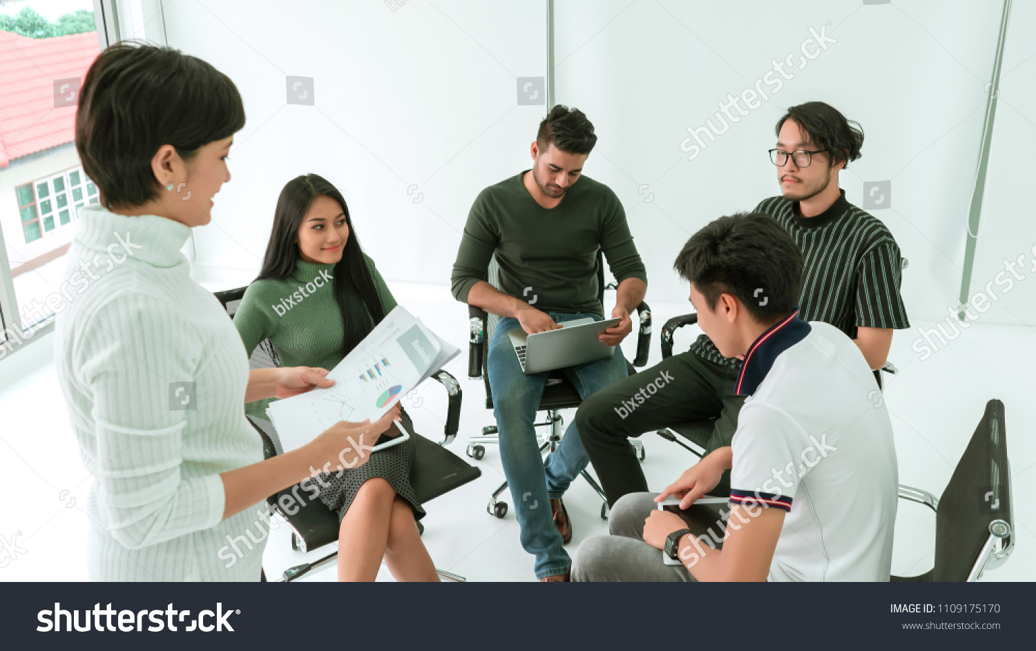 Business Team Sitting Circle Together Sharing Stock Photo