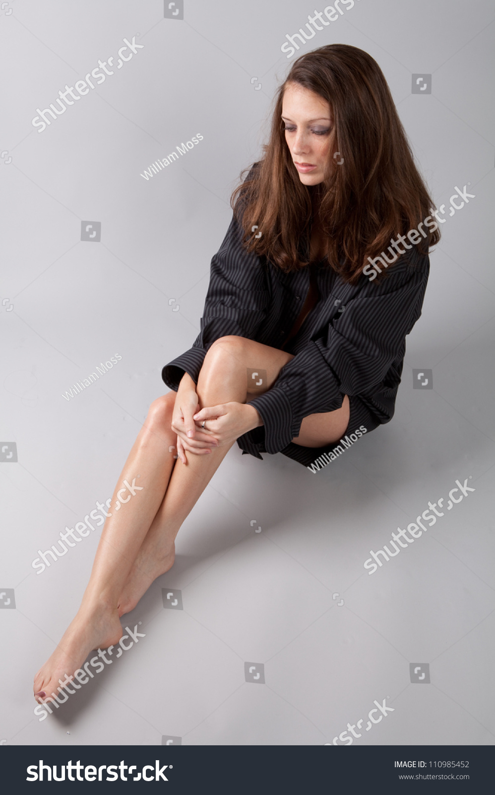 sexy woman man shirt bare legs stock photo (royalty free) 110985452