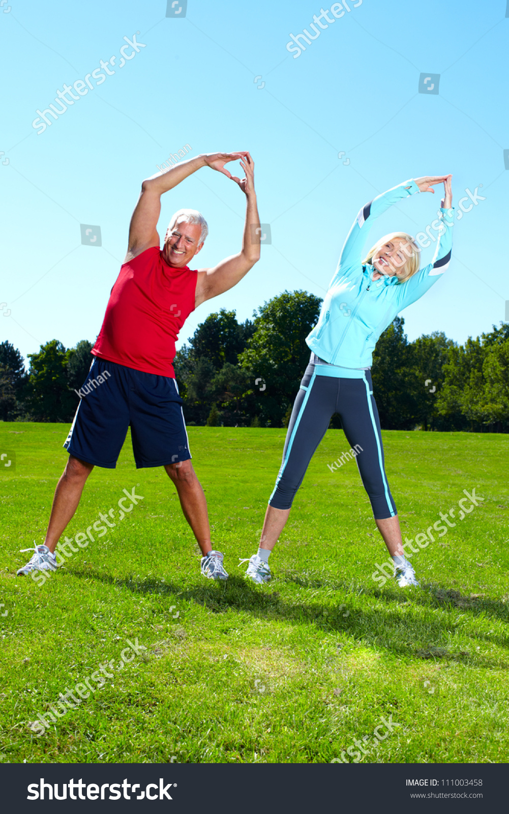 Happy senior fitness couple in the park
