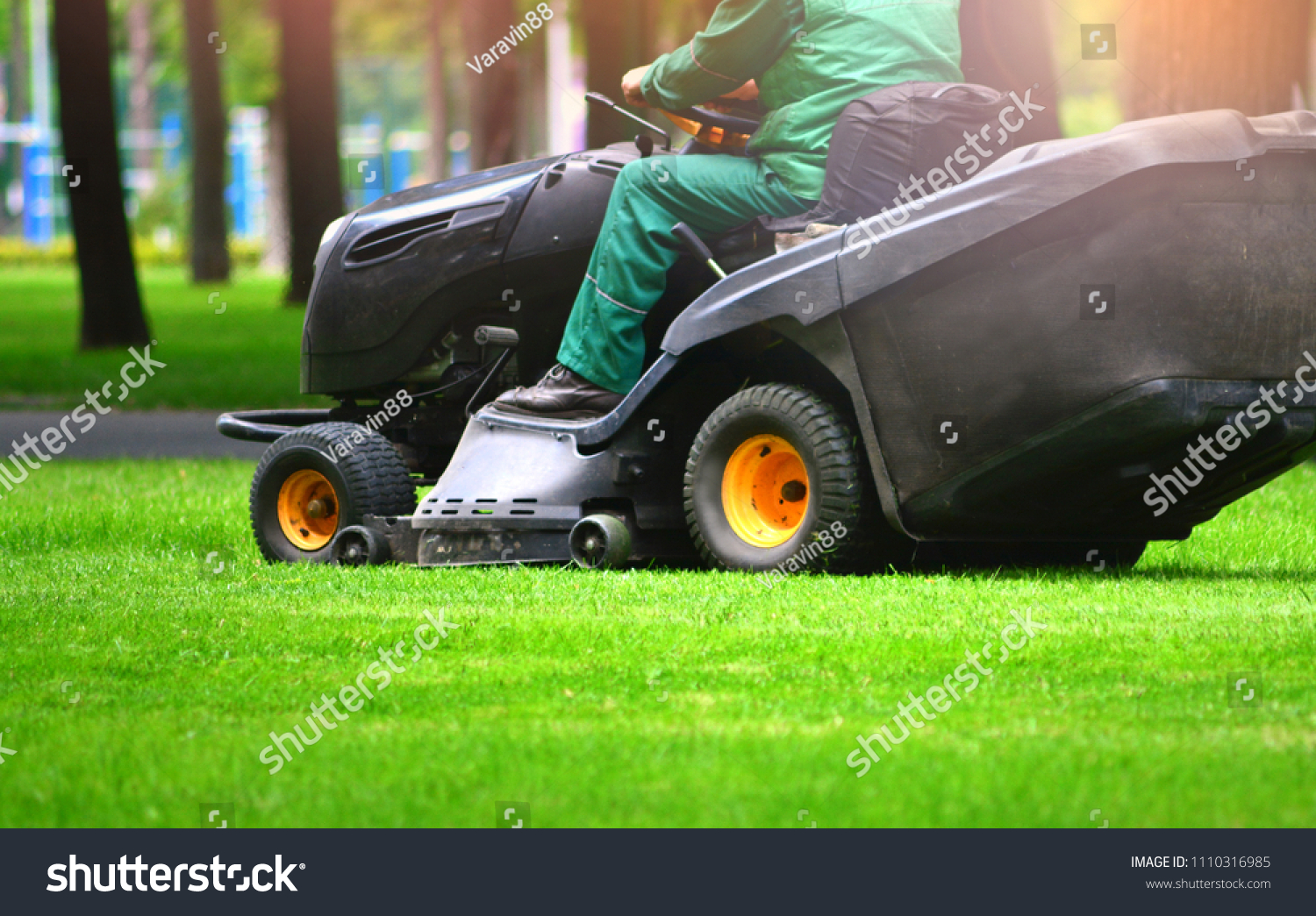 Professional lawn mower cuts the grass #1110316985