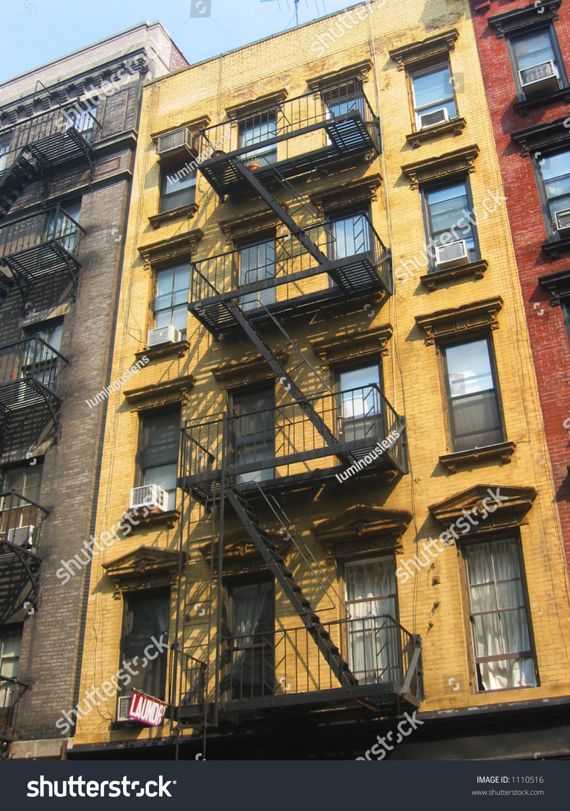 Fire Escapes Run Diagonally Down Colorful Stock Photo 1110516