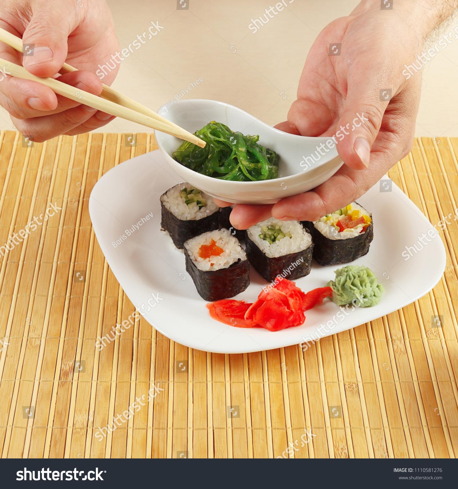 Hands Taking Hiyashi Wakame Salad Chopsticks Stock Photo