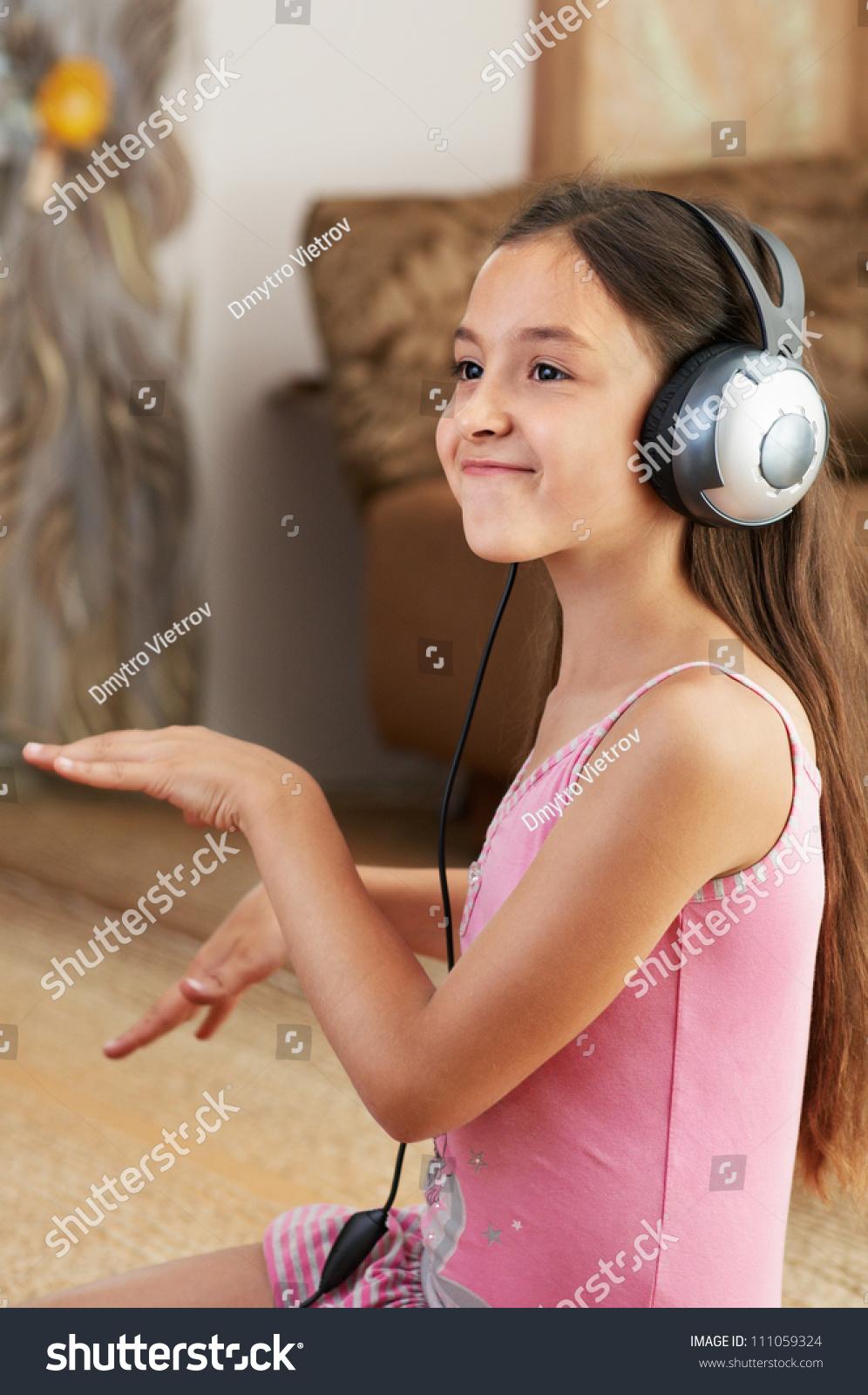 girl listening music dancing stock photo 111059324