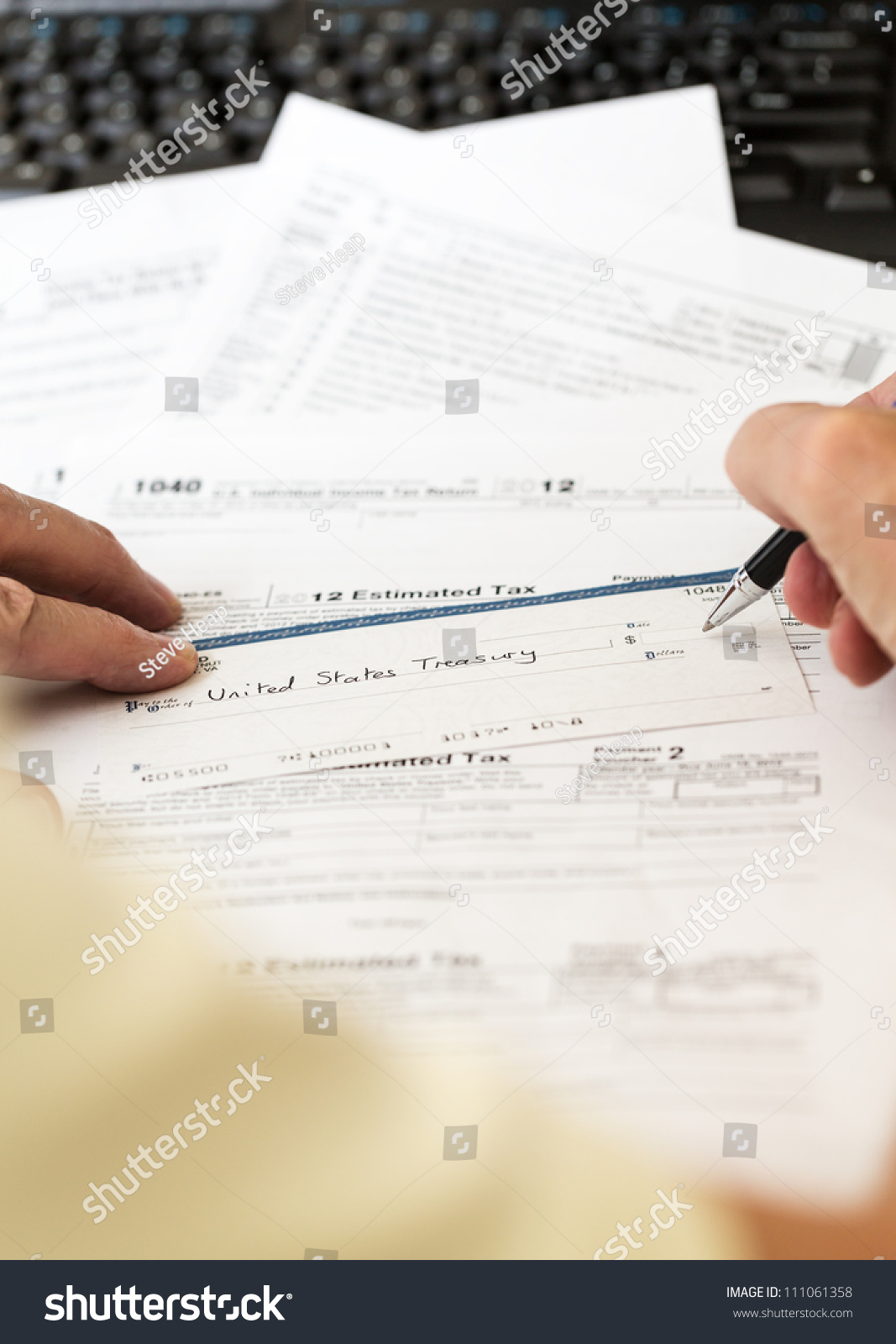 Tax form 1040 tax year 2012 stock photo 111061358 shutterstock tax form 1040 for tax year 2012 for us individual tax return with pen and check falaconquin