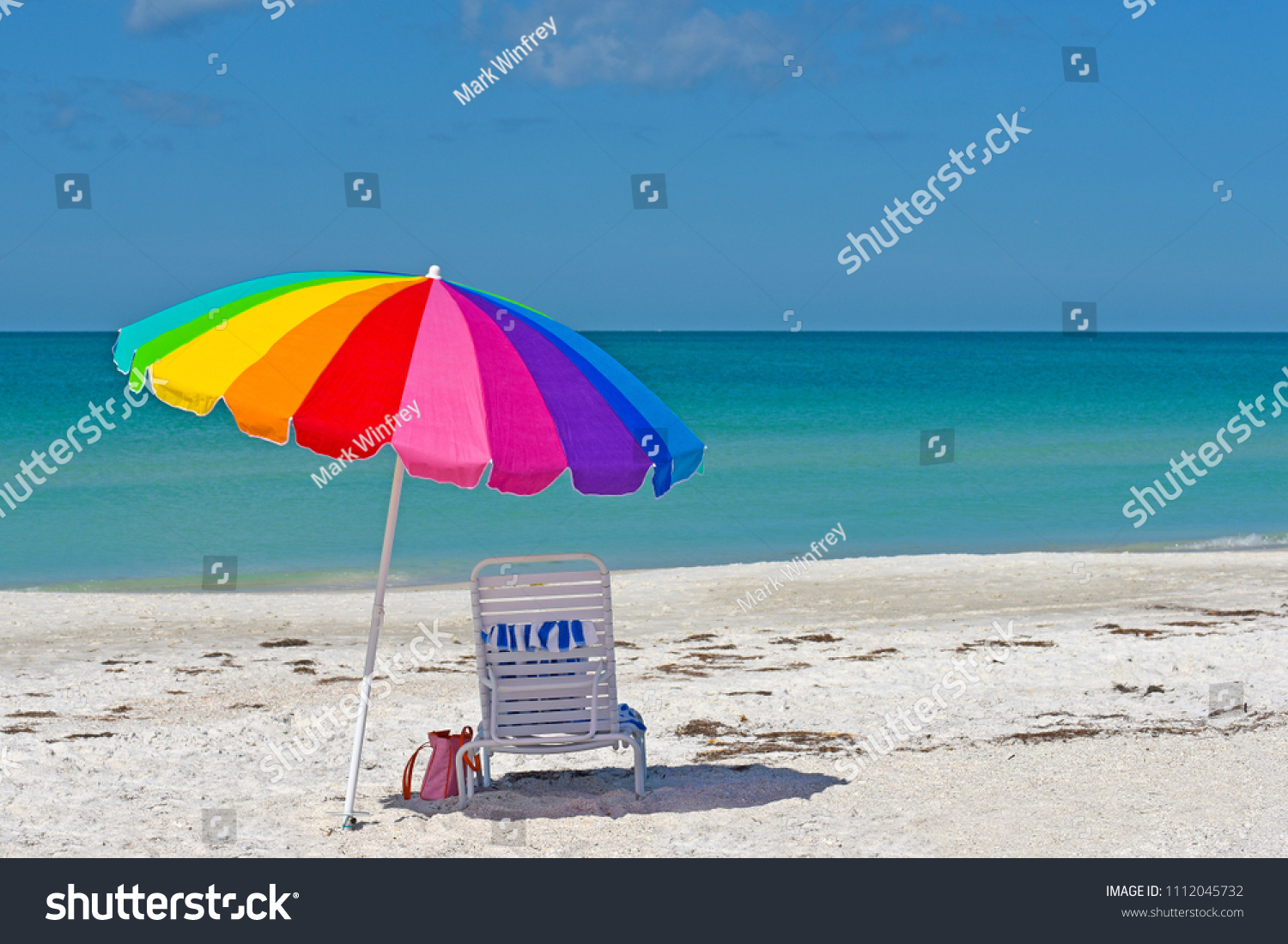 Colorful Umbrella and Chair on the Sandy Beaches of Anna Maria Island