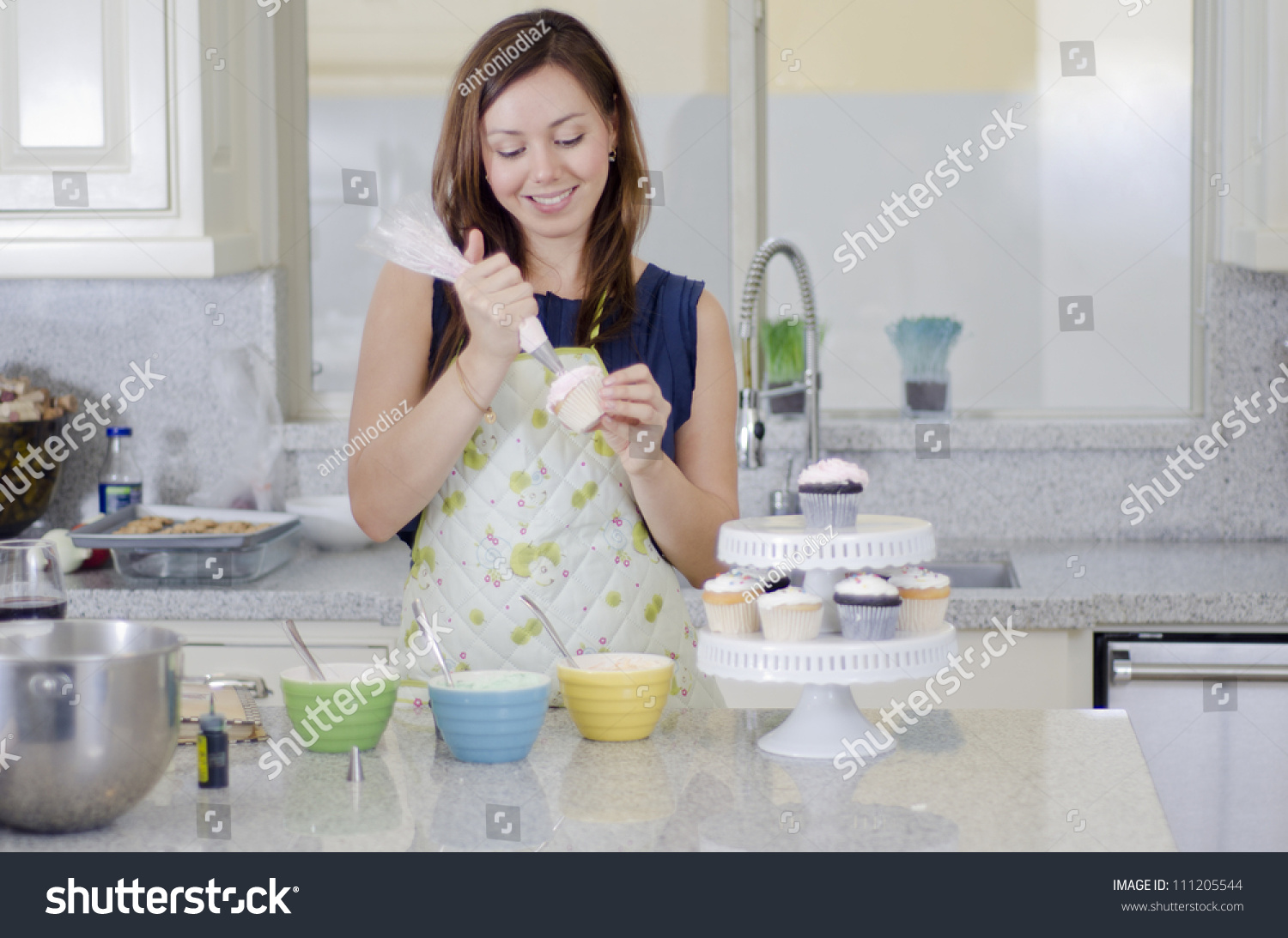 Cute Young Woman Decorating Cupcakes