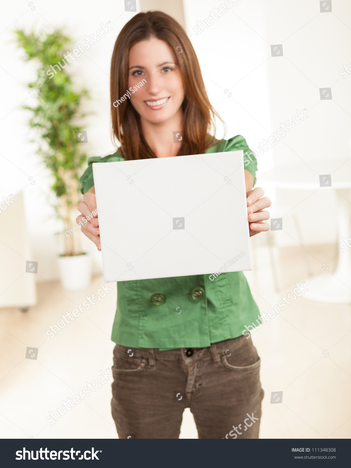Attractive Young Female Wearing Green Shirt And Brown Pants With ...