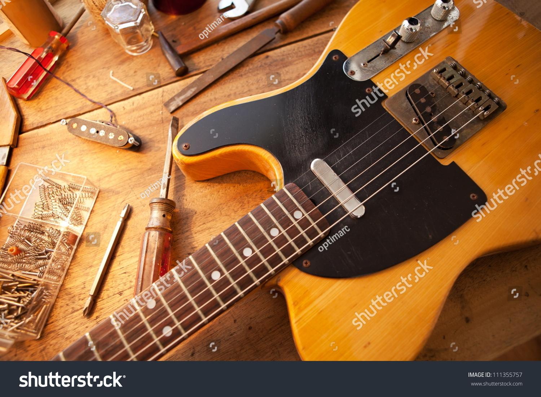 guitar on guitar repair desk vintage stock photo 111355757 shutterstock. Black Bedroom Furniture Sets. Home Design Ideas
