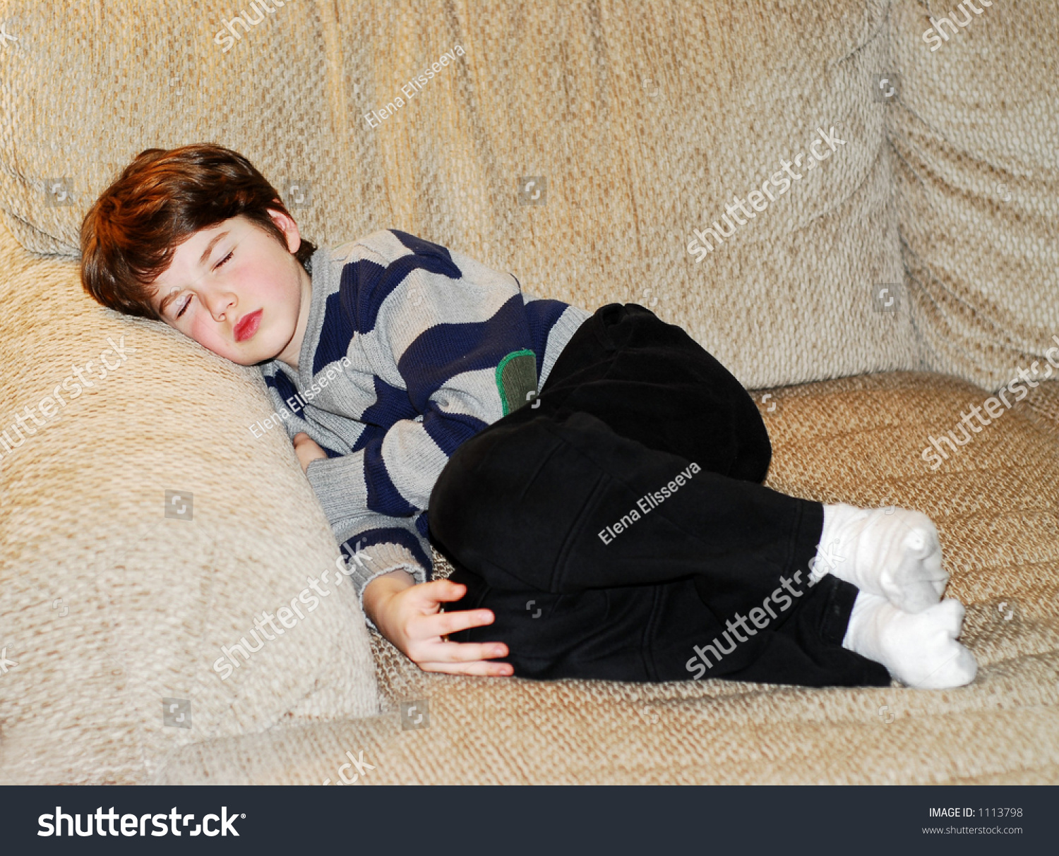 Cute little boy sleeping on a couch stock photo 1113798 for Couch you can sleep on