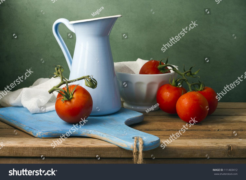 Still Life Tomatoes Enamel Jug Arrangement Stock Photo