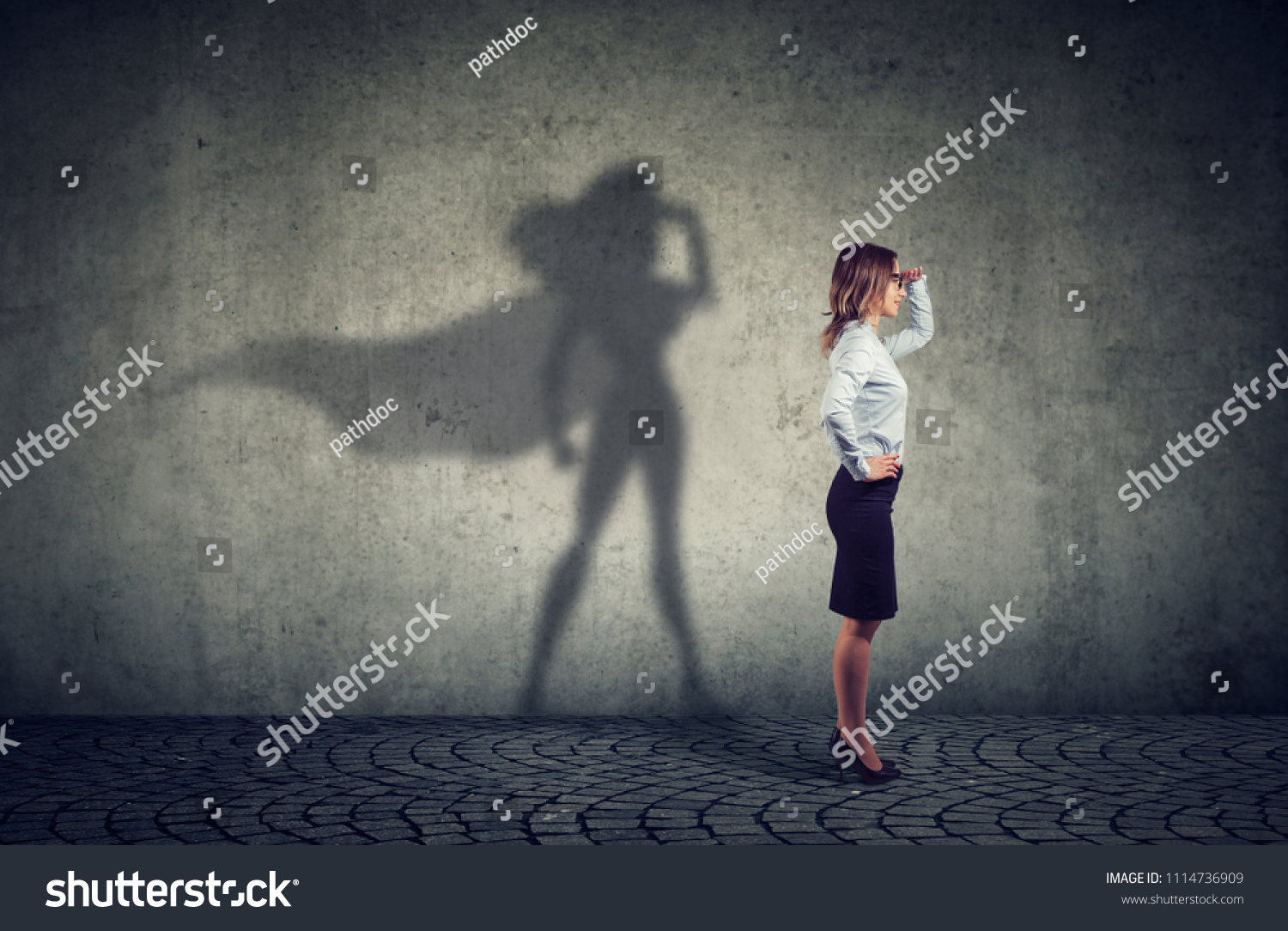Side view of a business woman imagining to be a super hero looking aspired.  #1114736909