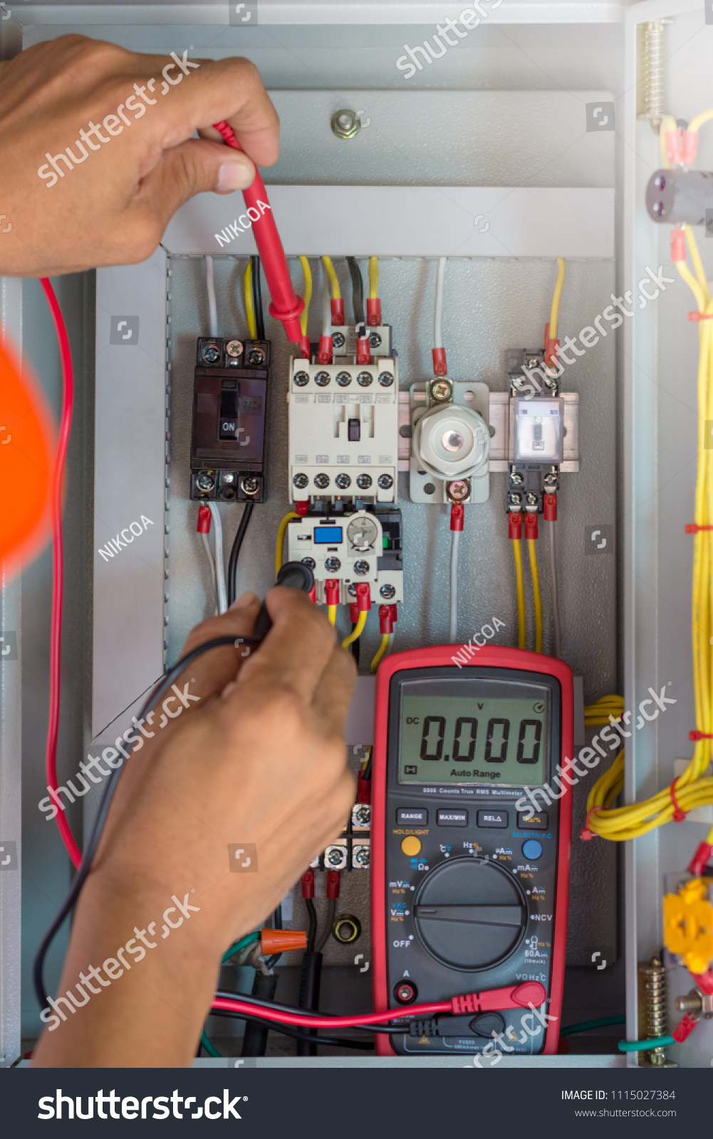 Electrician Checking Electrical Terminal Box Control Stock Photo Home Wiring Distribution Panel With Magnetic Contactor And Overload Relay Measuring