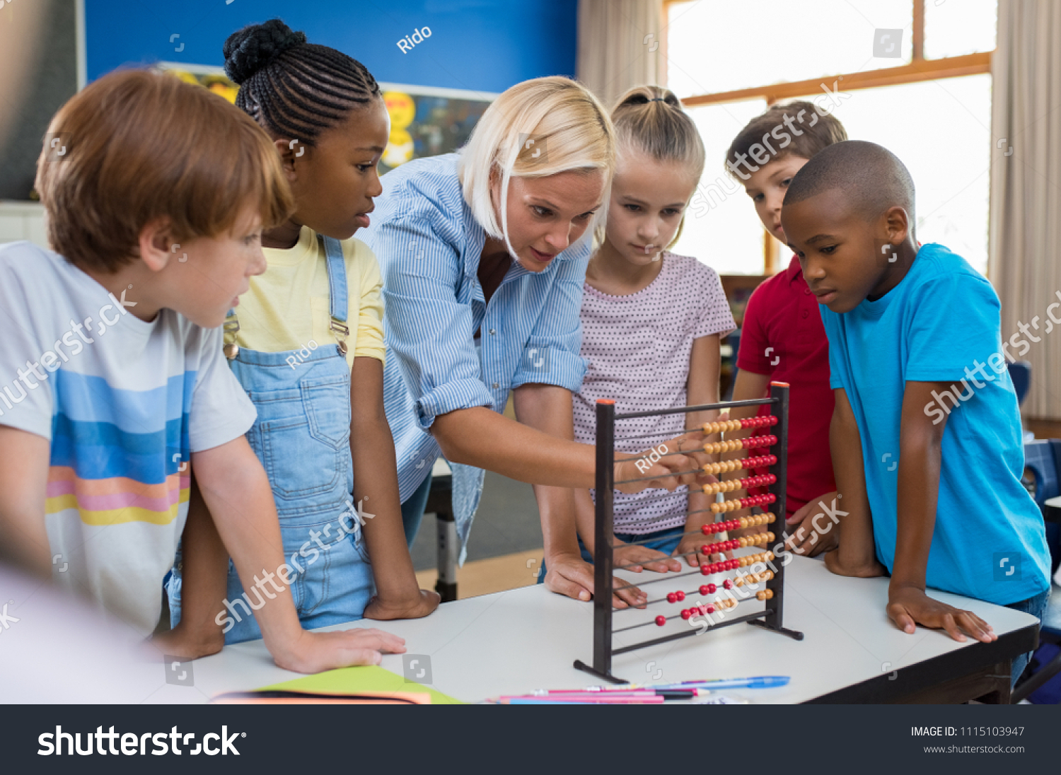 Teacher Teaching Children Math On Abacus Stock Photo (Royalty Free ...