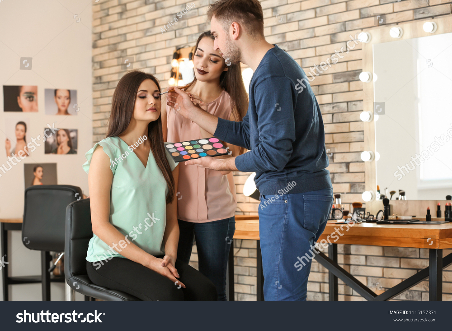Professional makeup artist teaching trainee in salon. Apprenticeship concept