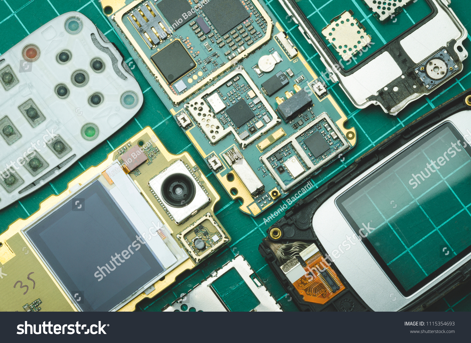 Dismantled Spare Parts Old Mobile Phone Stock Photo Edit Now Keypad Circuit Board Of A Download Technology For On Green Background Close Up