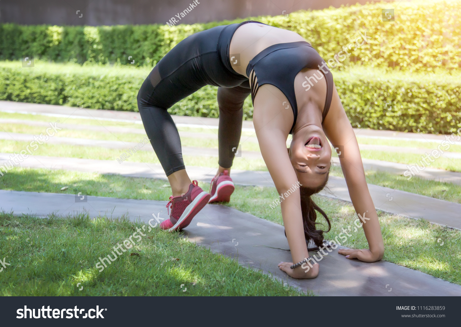asian lady happy action with yoga position on park. Healthy activities concept. #1116283859