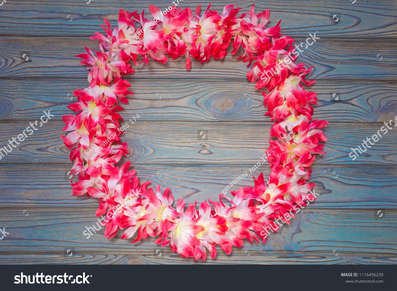 Hawaiian garland flowers wreath on wooden stock photo safe to use hawaiian garland of flowers wreath on a wooden background izmirmasajfo