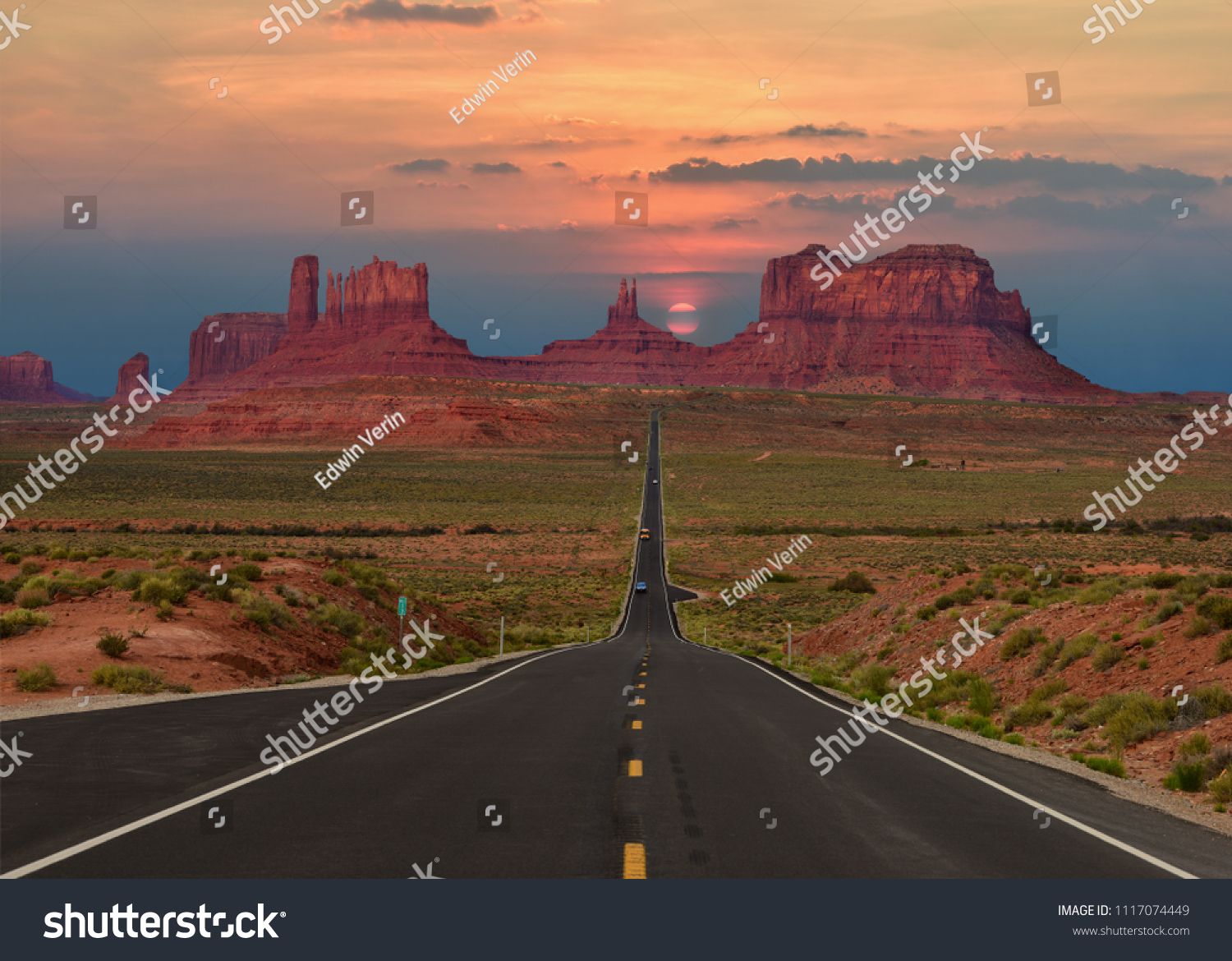 Scenic highway in Monument Valley Tribal Park in Arizona-Utah border, U.S.A. at sunset. #1117074449