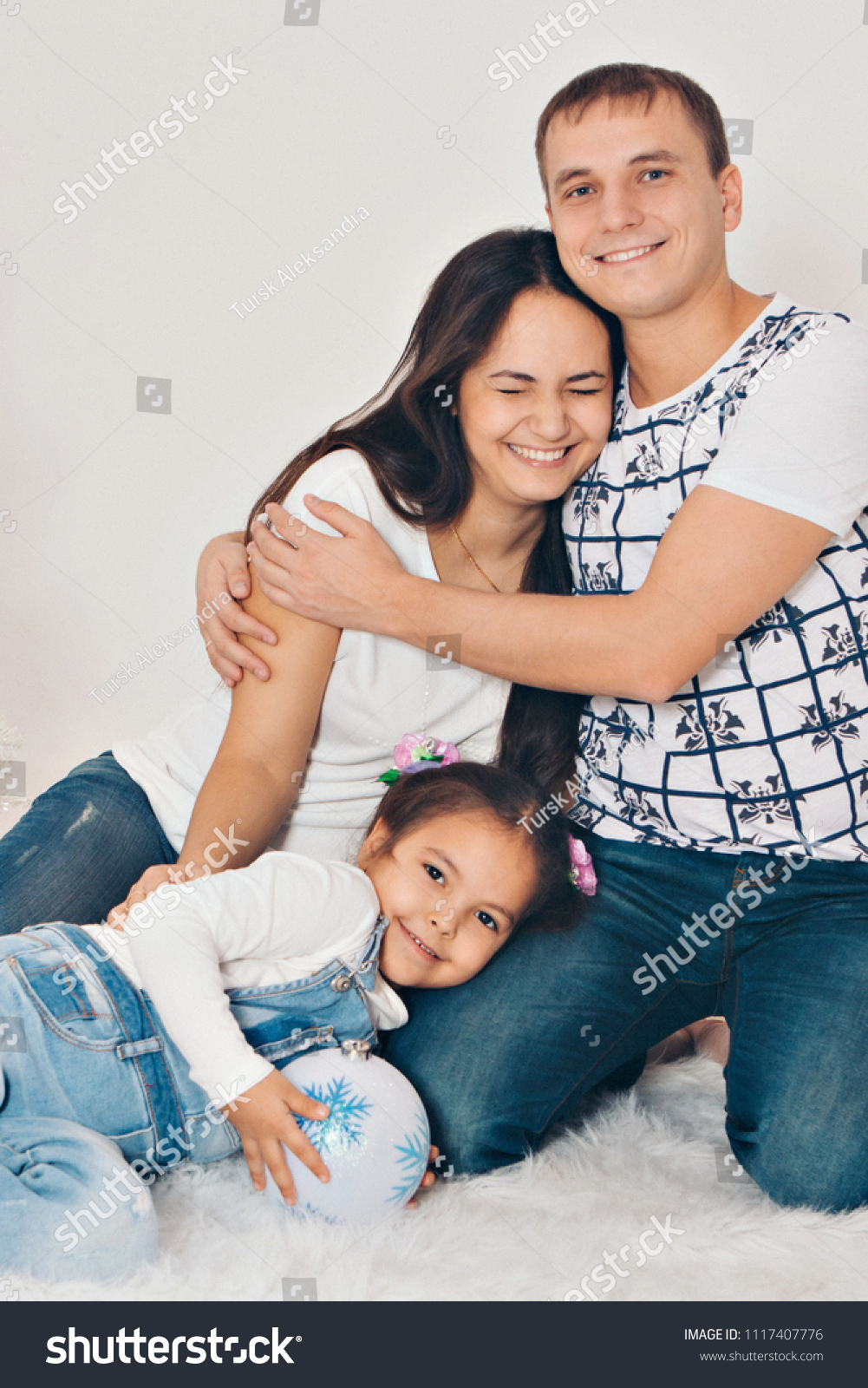 Family portrait on the floor on white background