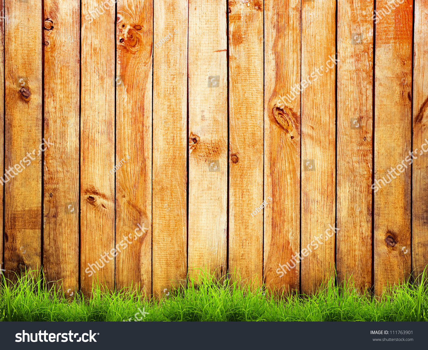 Fresh spring green grass over wood stock photo