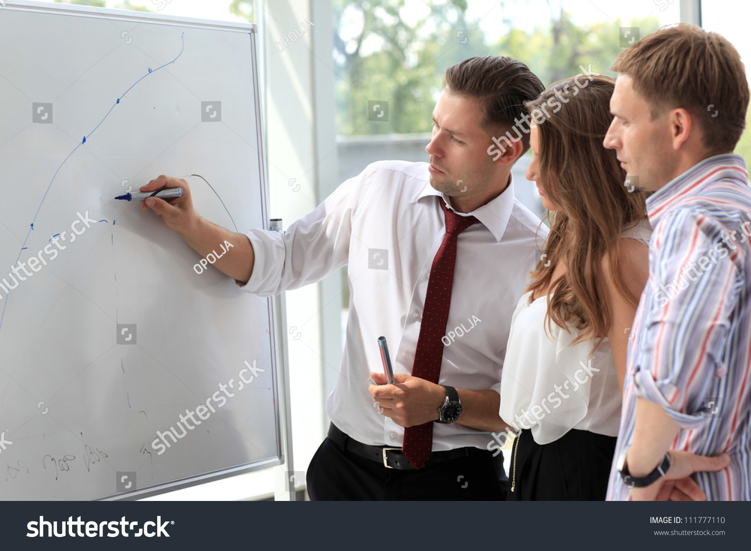 Business People Looking At Their Leader While She