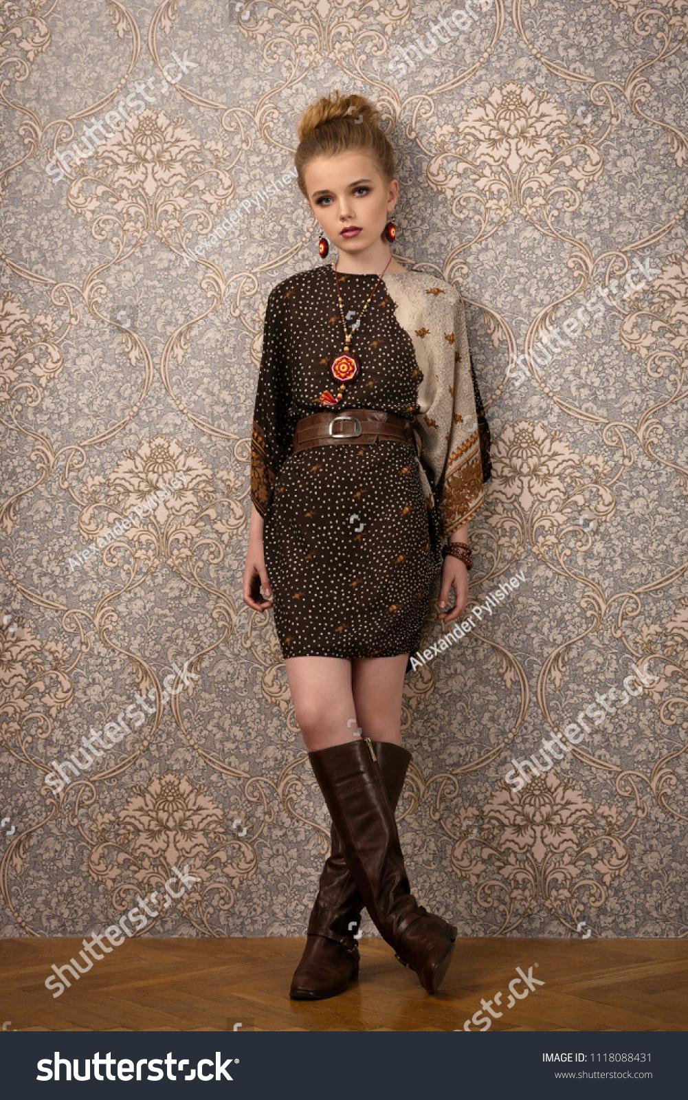 beautiful teen girl in retro dress on Wallpaper background