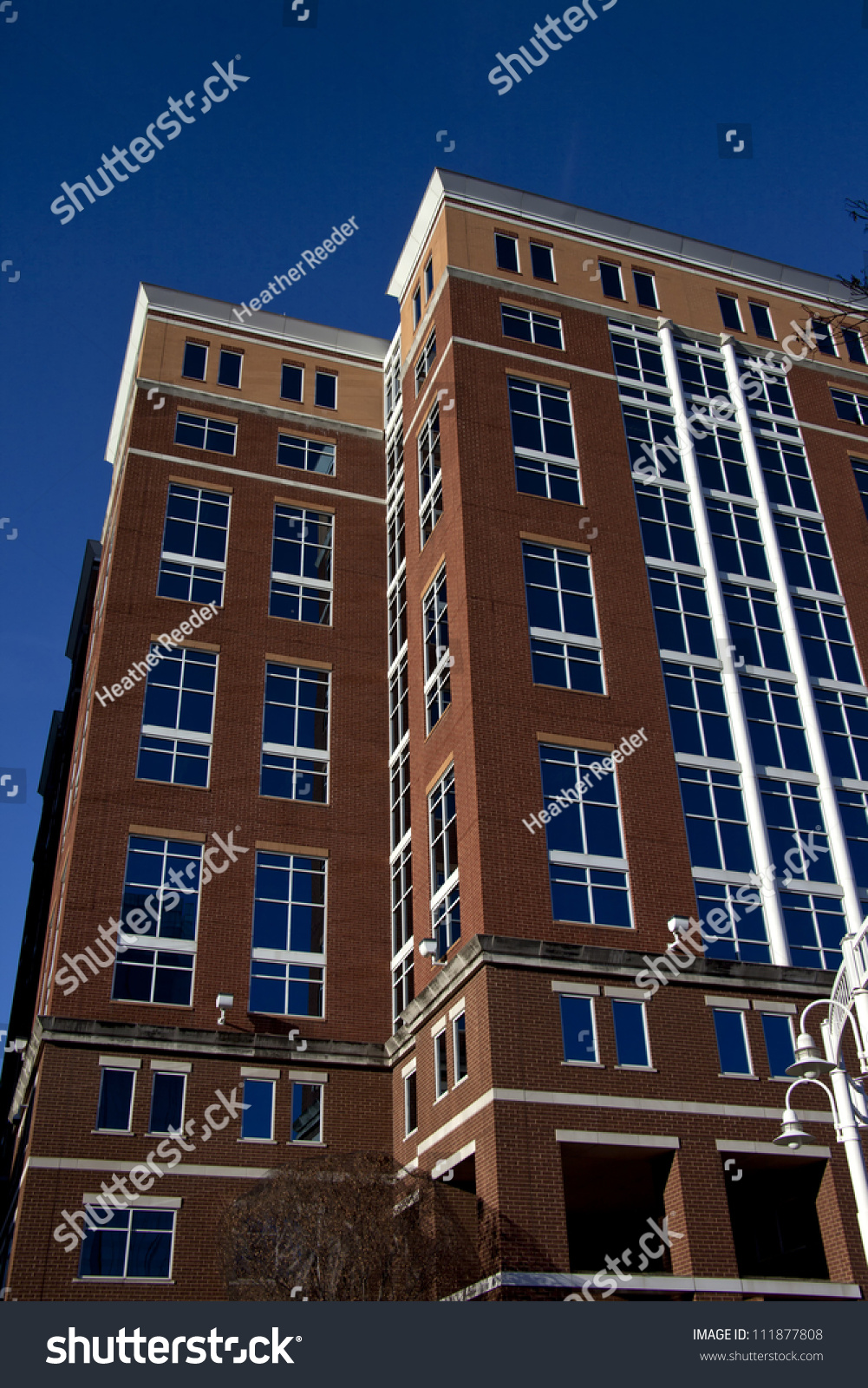 tall brick building blue tinted windows stock photo 111877808 shutterstock. Black Bedroom Furniture Sets. Home Design Ideas