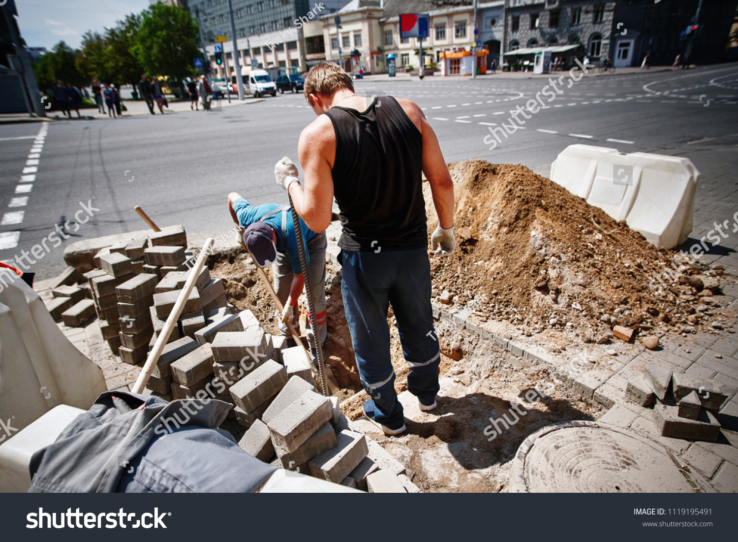 Two Workers Dig Trench On Pedestrian Stock Photo (Edit Now