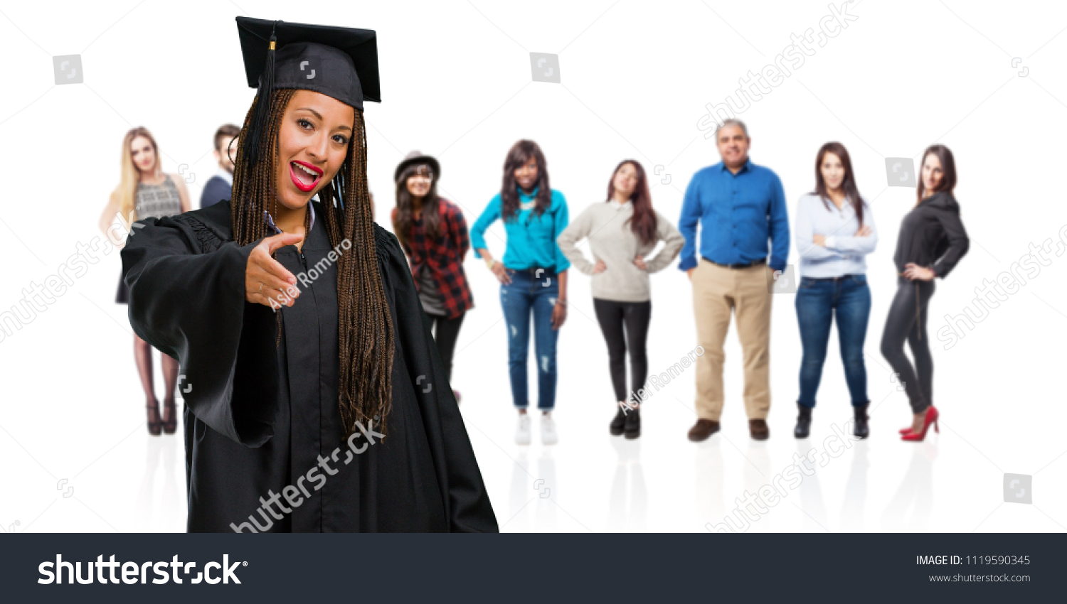 Young graduated black woman wearing braids stock photo royalty free young graduated black woman wearing braids reaching out to greet someone or gesturing to help m4hsunfo