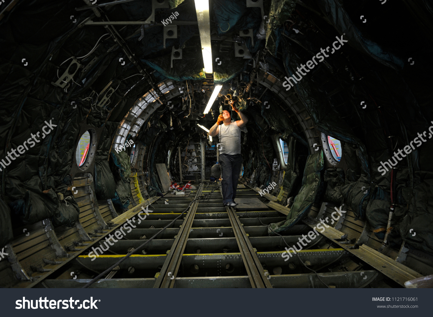 Superb Plane Overhauling Electrician Installing New Electrical Stock Photo Wiring Digital Resources Minagakbiperorg