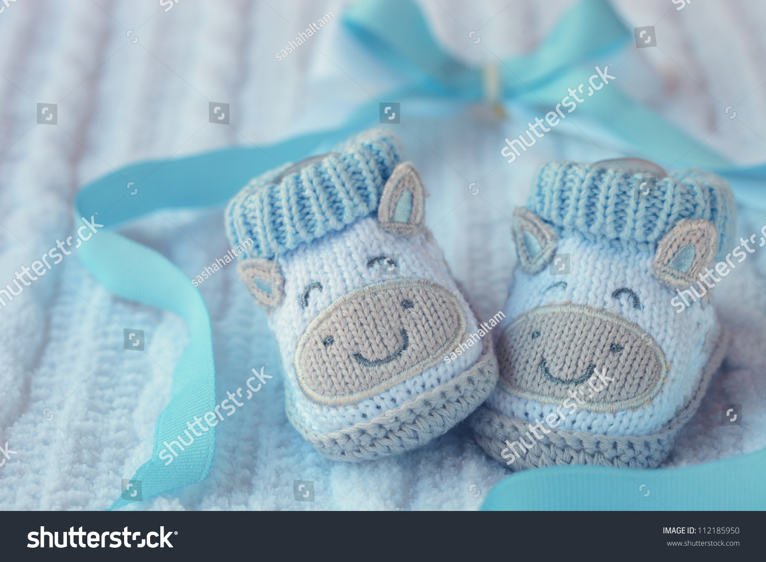 Knitted Baby Shoes Boy On Blue Stock Photo 112185950 - Shutterstock