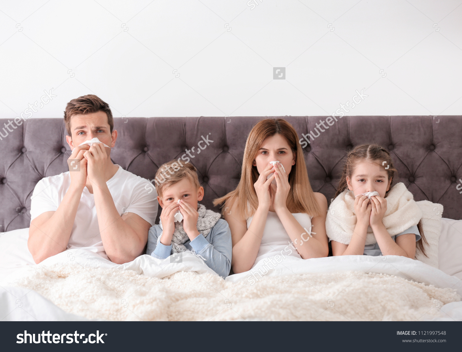 Family suffering from cold in bed at home #1121997548