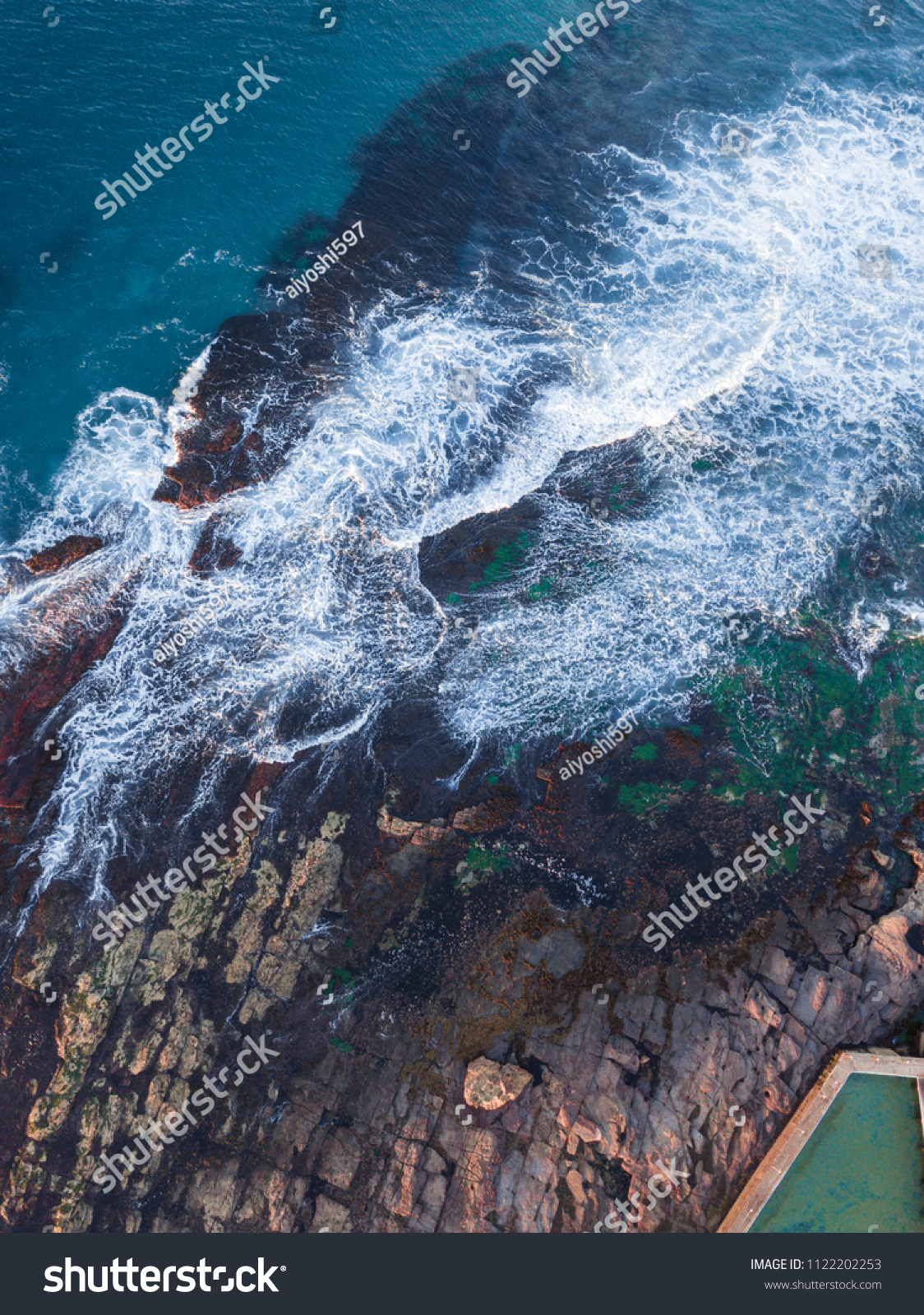 Aerial view of small wave around the rocks. #1122202253