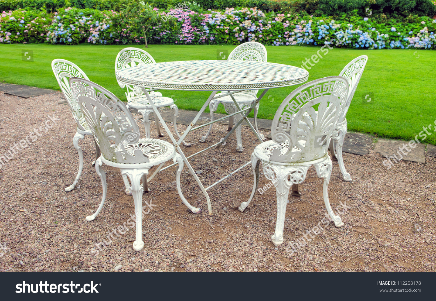 Vintage wrought iron table - Vintage Wrought Iron Garden Table And Six Chairs In An English Garden
