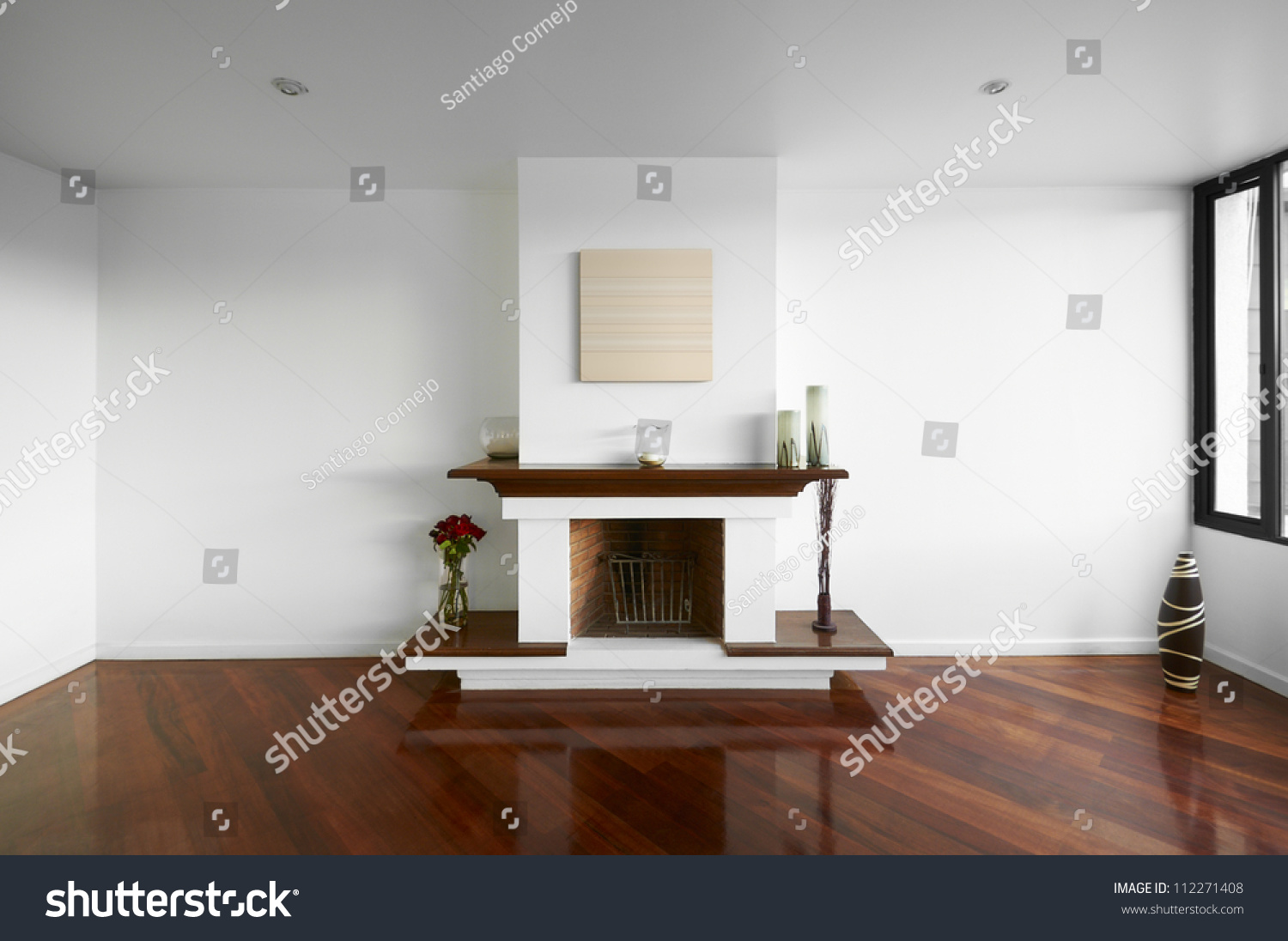 Big empty living room - Big Empty Living Room With A Chimney White Wall And Wooden Floor