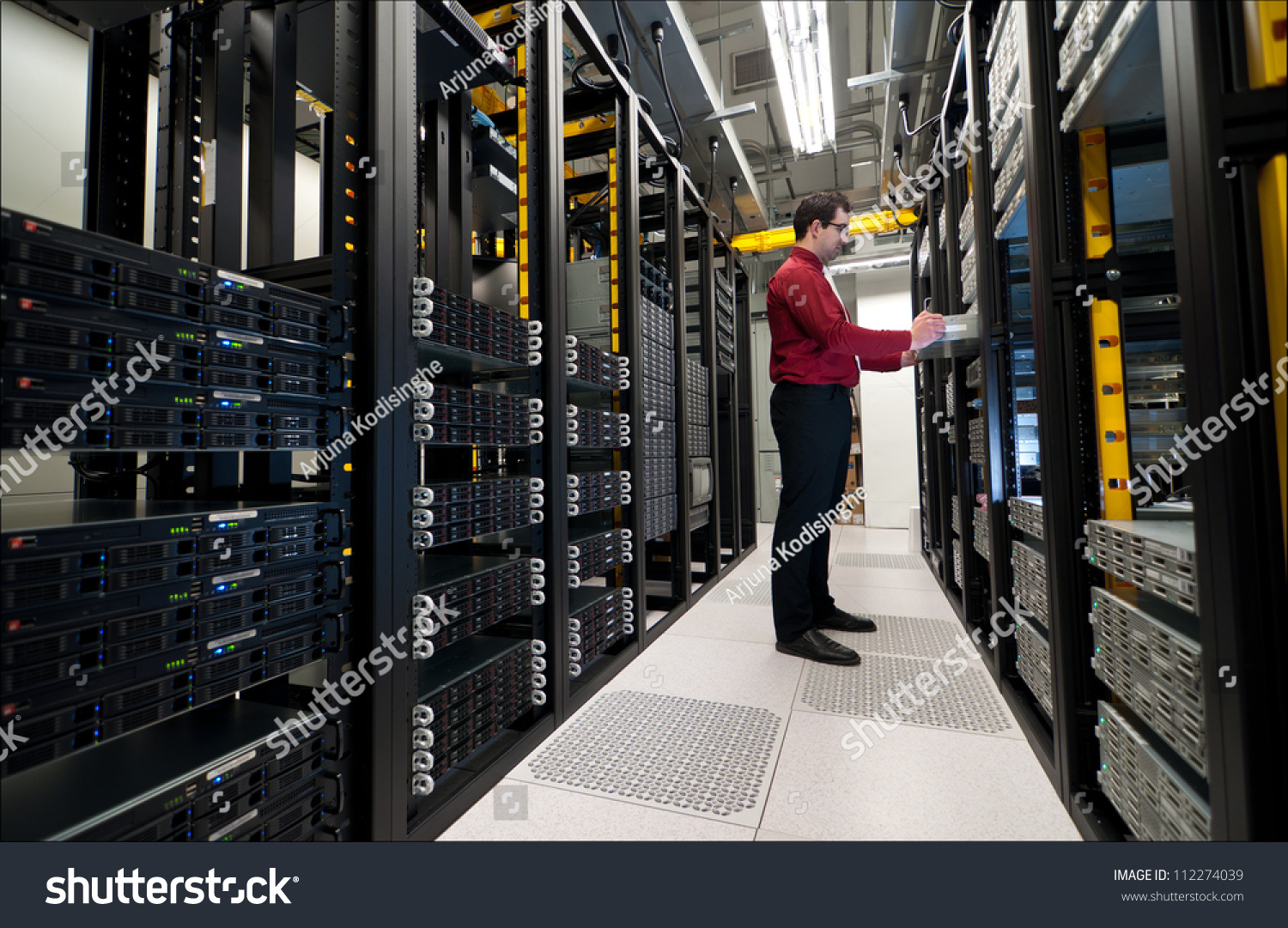 Administrator - Young it administrator installing a new rack mount server large scale storage server is also