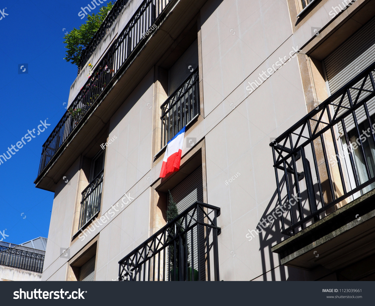 PARIS, FRANCE - JUNE 28, 2018: A French flag is displayed on a balcony in support of the French team in the 2018 World Cup on June 28, 2018 in Paris, France.