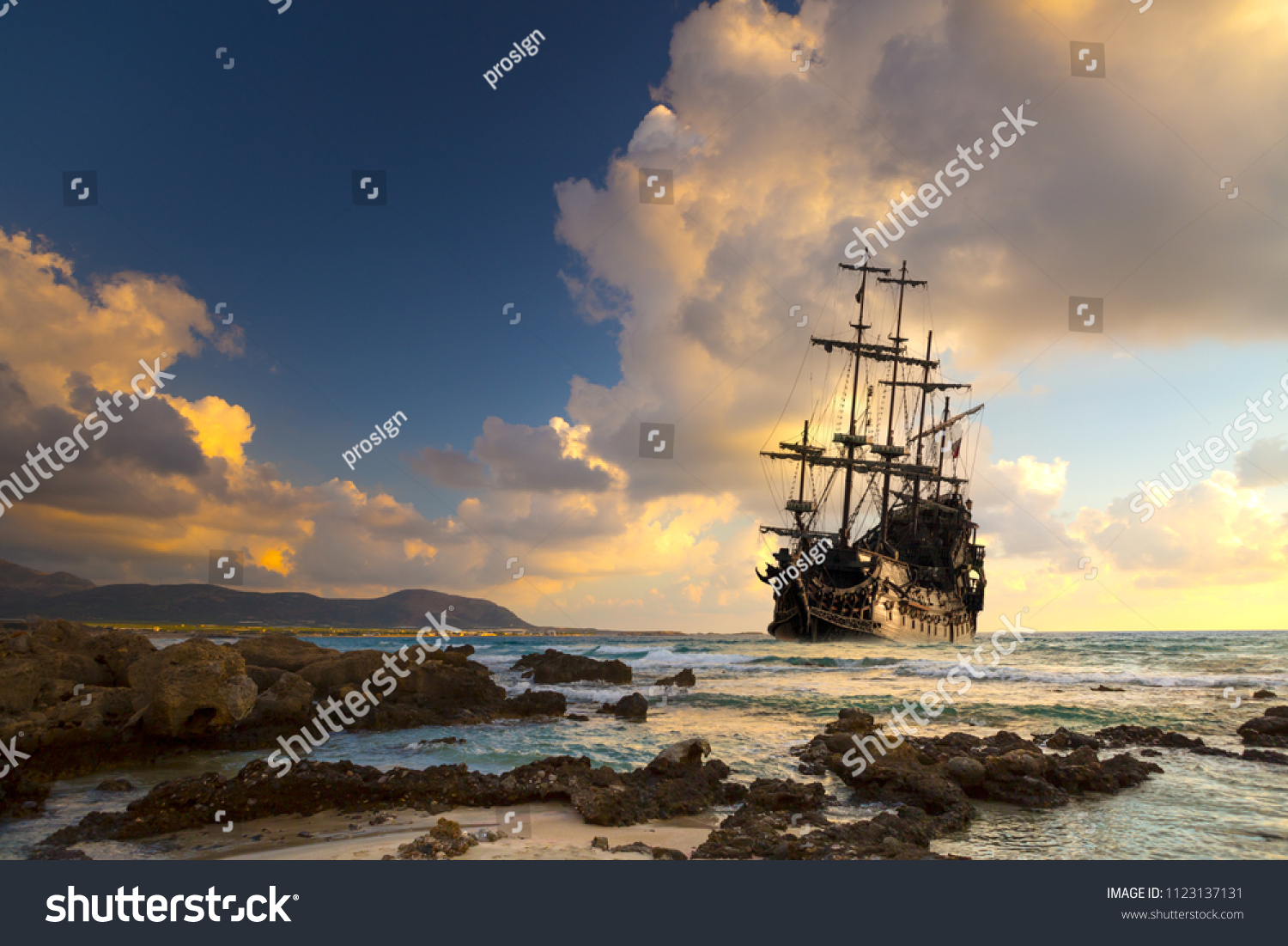 Pirate ship at the open sea at the sunset #1123137131