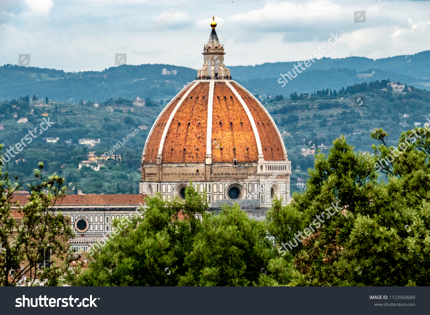 Unidentifiable people can be seen at the top of the Duomo, at the Florence Cathedral, as viewed from the nearby hillside of the Boboli Garden.