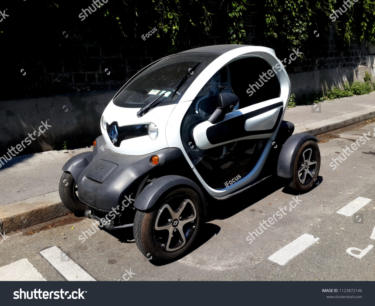 PARIS, FRANCE - JUNE 30, 2018: An all-electric car Renault Z.E. - that stands for Zero Emission- is parked on a street on June 30, 2018 in Paris, France.