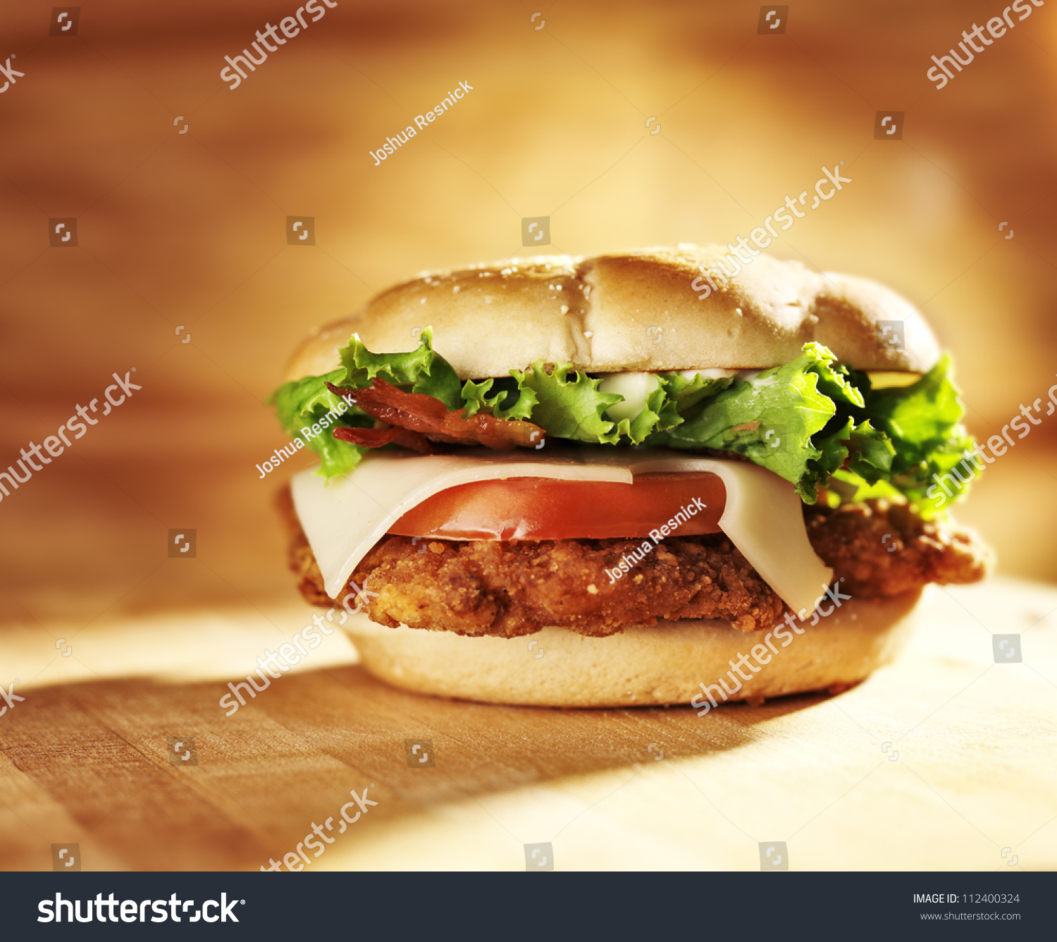 Crispy Chicken Sandwich With Bacon And Swiss Cheese. Stock Photo ...