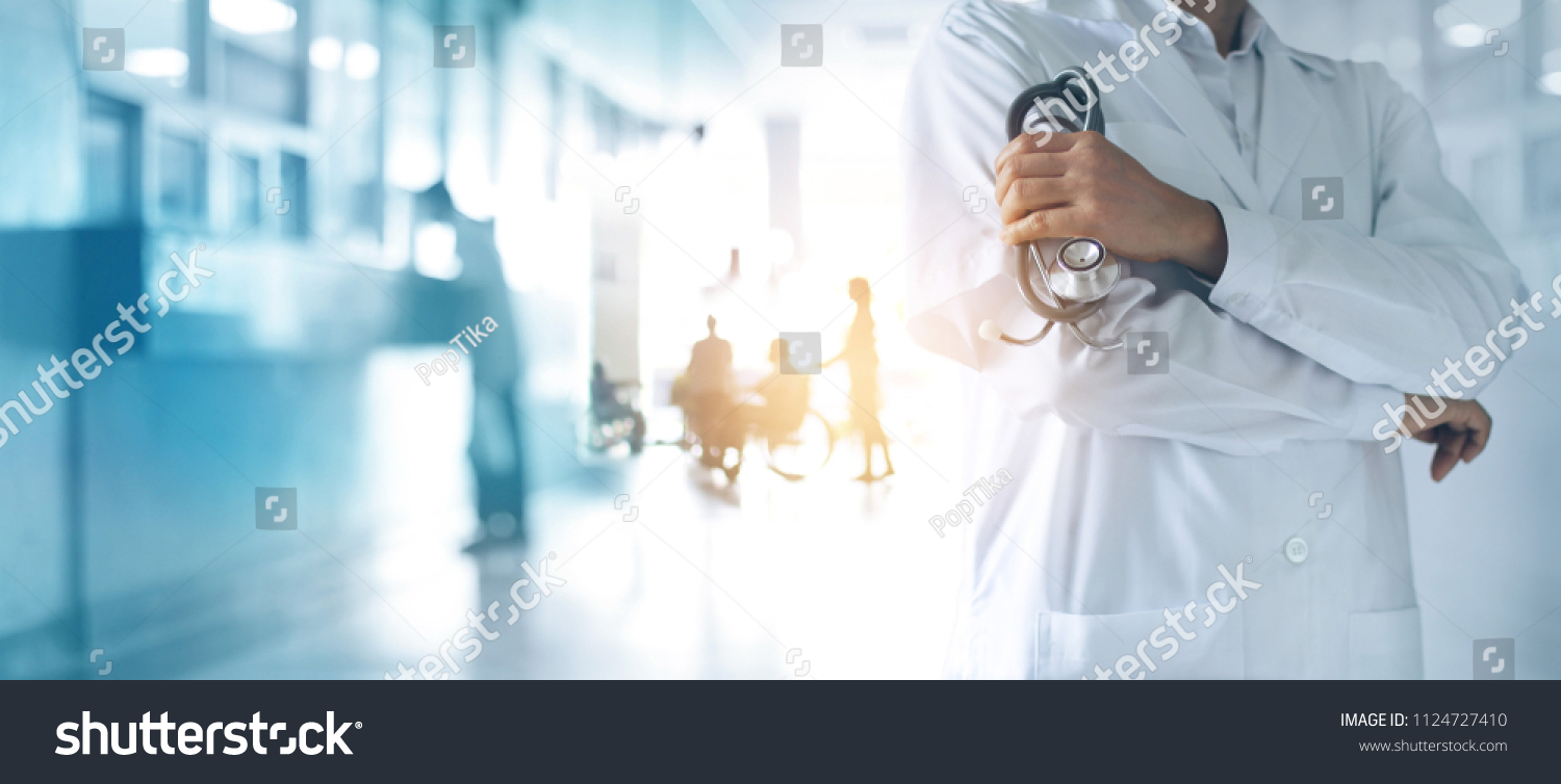 Healthcare and medical concept. Medicine doctor with stethoscope in hand and Patients come to the hospital background. #1124727410