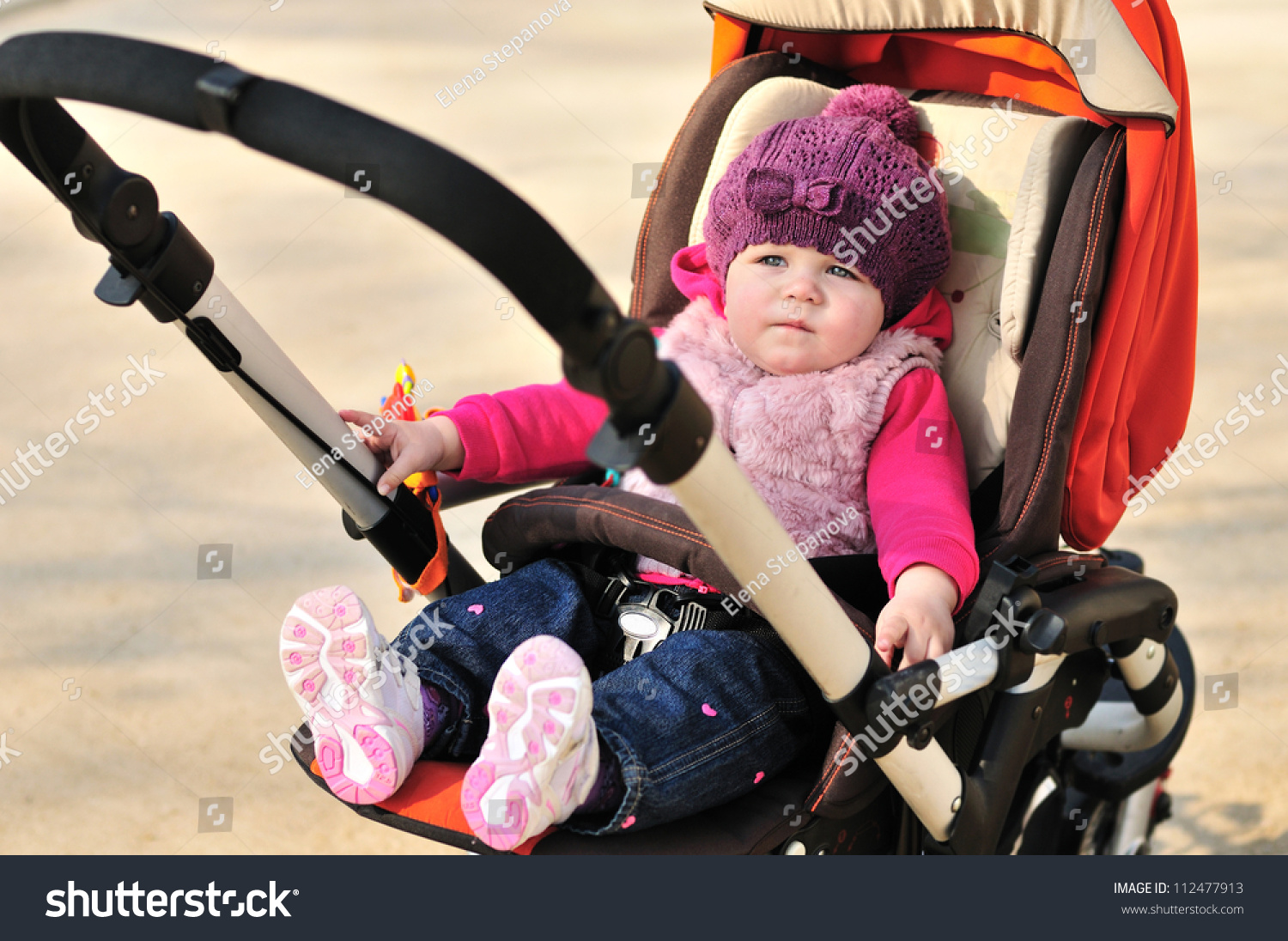 cute baby girl sitting in stroller stock photo 112477913   shutterstock