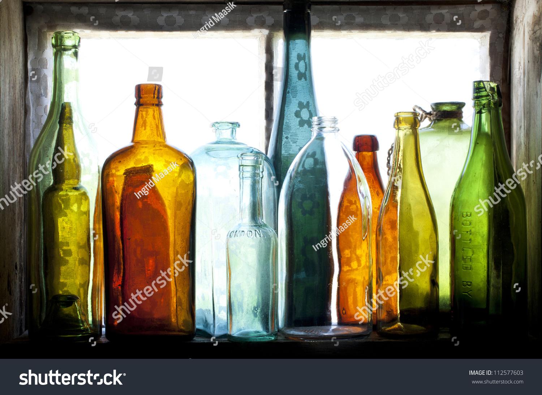Old Glass Bottles Part - 40: Old Glass Bottles On Window
